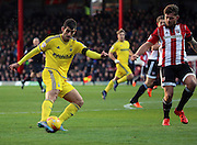 Nottingham Forest striker Nelson Oliveira with a shot on goal during the Sky Bet Championship match between Brentford and Nottingham Forest at Griffin Park, London, England on 21 November 2015. Photo by Matthew Redman.