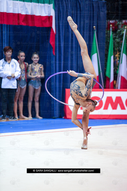 DESIO, ITALY - OCTOBER 31 2015: Dina Averina of Lazio Ginnastica Flaminio performs with hoop at the italian national rhythmic gymnastic championship. Her score in the apparatus is 17,000. Her team's score is 87,250 and ended up in second position.