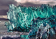 Seen from a small wooden boat in an ice-laden lagoon, the sixty-foot face of San Rafael Glacier looked especially large, particularly when a fifty-ton chunk broke loose and crashed into the water in front of us. Rolling over and resurfacing as an iceberg, it displayed its jewel-like beauty to the world. But its newborn splendor was brief, as its finely cut edges and deep clear color were quickly dulled by the warmth of the sun. Front-lit and seen from a distance, the iceberg looked black and void of form. But when we maneuvered behind it so that it was backlit by the sun, we were shown the full glory of God's fleeting creation.