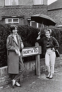 Jill and Jacqui standing next to North Road street sign, Southall, UK, 1985
