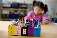 Kindergarten student Jenny Lu, 5, works on a class assignment with a box of crayons labeled in Chinese for each color, at West Portal Elementary School, in San Francisco, Ca., on Friday, Sept. 11, 2009. The Chinese immersion program, the first in the U.S., celebrates its 25th anniversary. Since then, many Chinese programs have opened in the city and the country.