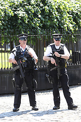 June 19, 2017 - London, London, United Kingdom - Image licensed to i-Images Picture Agency. 19/06/2017. London, United Kingdom. Police outside the Houses of Parliament in Westminster , United Kingdom , observe a  one minute's silence for the victims of Grenfell Tower fire. Picture by Stephen Lock / i-Images (Credit Image: © Stephen Lock/i-Images via ZUMA Press)