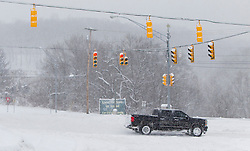 Saturday, Jan. 22, 2016: A truck travels through an intersection on Chaplin Road in Morgantown, W.Va. after Winter Storm Jonas ripped through North Central West Virginia and dumped nearly 18 inches of snow. (Photo by Ben Queen)