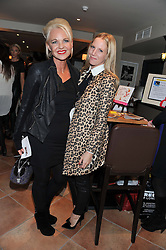Left to right, AMANDA ELIASCH and her god daughter ALICE NAYLOR-LEYLAND at the Delicious Glamourous Girls Christmas Bazaar held at The Little Black Gallery & 11 Park Walk, Park Walk, London on 27th November 2012.
