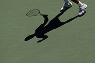 US Open 2008, USTA Billie Jean National ..Tennis Center,New York, Sport, Grand Slam Tournament,View from above of a shadow of player and racket on green hardcourt surface.