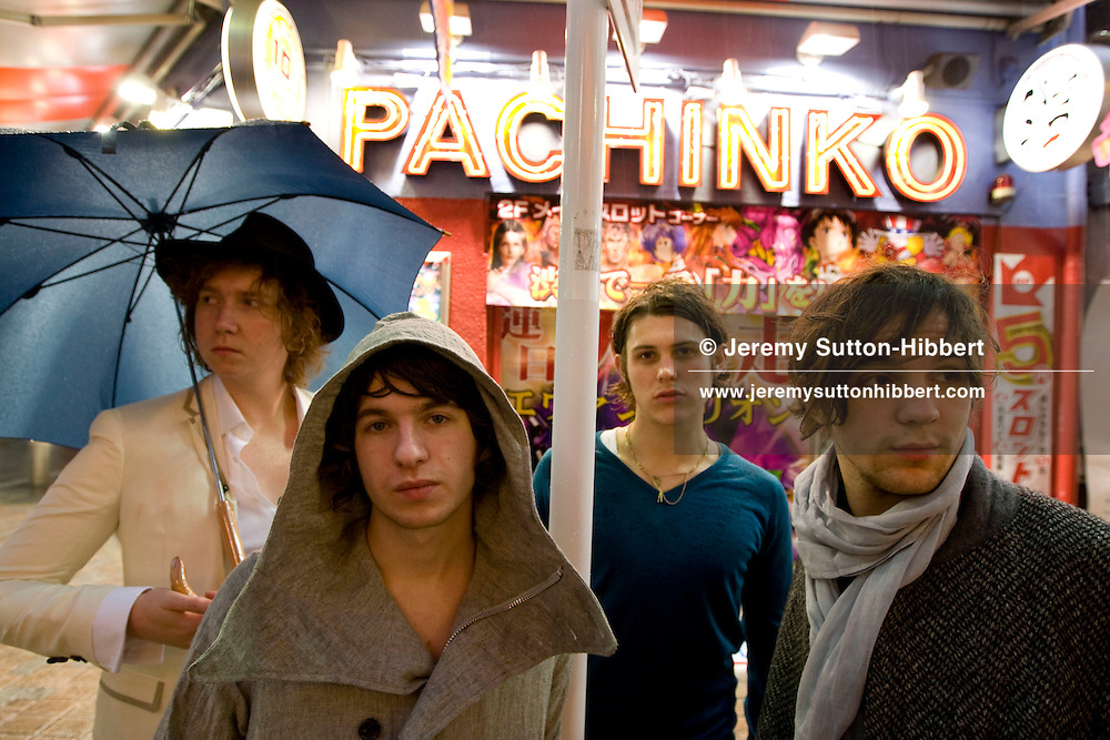 Luke Pritchard (grey coat with hood),  Hugh Harris (white jacket, black hat), Paul Garred (green sweater), and Dan ? (grey jacket, no hood, scarf), of British pop band The Kooks, Tokyo, Japan, on Wednesrday, March 19th, 2008. .