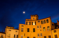 LUCCA ITALY - CIRCA MAY 2015:  View of buildings around the Piazza Anfiteatro at night in Lucca, an historic town in Tuscany