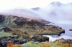 Morning mists rising over small loch; Trotternish; Island of Skye; Scotland