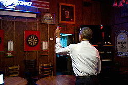 President Barack Obama throws darts at Manuel's Tavern in Atlanta, Ga., March 10, 2015. (Official White House Photo by Pete Souza)<br /> <br /> This official White House photograph is being made available only for publication by news organizations and/or for personal use printing by the subject(s) of the photograph. The photograph may not be manipulated in any way and may not be used in commercial or political materials, advertisements, emails, products, promotions that in any way suggests approval or endorsement of the President, the First Family, or the White House.