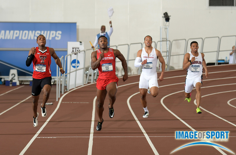 Mar 10, 2018; College Station, TX, USA; Elijah Hall of Houston (second from left) wins the 200m in a collegiate record 20.02  during the NCAA Indoor Track and Field Championships at the McFerrin Athletic Center. From left: Divine Oduduru (Texas Tech), Hall, Kenzo Cotton (Arkansas) and Ncincilili Titi (South Carolina).
