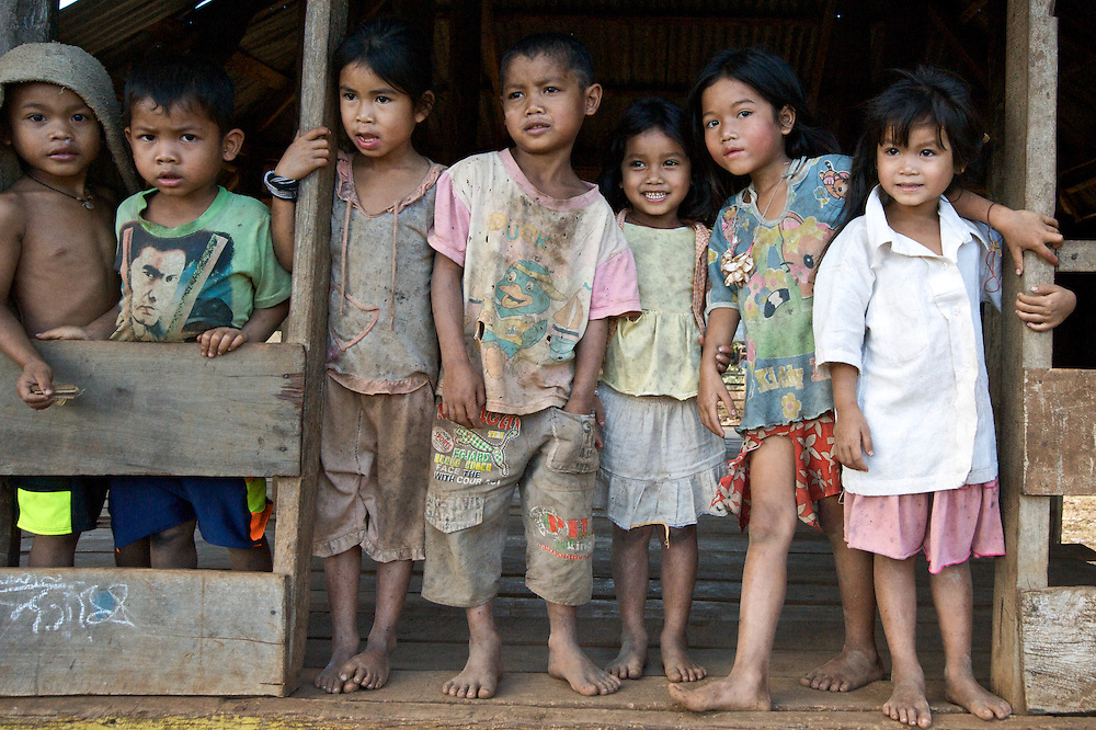 A group of kids pause for a picture while playing on the grounds of the village wat (temple) on the Bolaven Plateau, southern Laos.