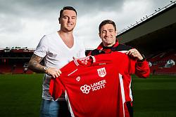 Bristol City's new signing Lee Tomlin and Manager Lee Johnson pose ahead of their 2016/17 Sky Bet Championship Campaign - Mandatory byline: Rogan Thomson/JMP - 04/07/2016 - FOOTBALL - Ashton Gate Stadium - Bristol, England - Bristol City New Signings.