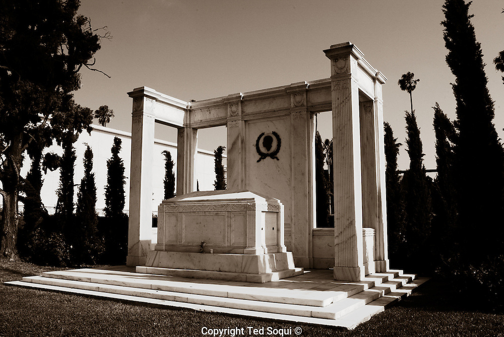 This is the burial site of Douglas Fairbanks 1883-1939 and Douglas Fairbanks Jr. 1909-2000. This popular site has a reflecting pool located in front of it and often has movie nights which project on an adjacent wall..They were both impressive Hollywood stars..5/21/04.Hollywood Forever cemetery, Hollywood, CA USA.