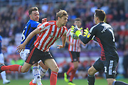 Jon McLaughlin claims the ball under pressure from Matty Gillam during the EFL Sky Bet League 1 match between Sunderland and Rochdale at the Stadium Of Light, Sunderland, England on 22 September 2018.