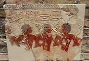 Fragments of reliefs: Egyptian soldiers and Nubian mercenaries. New Kingdom, Dynasty 18, around 1470 BC Deir el-Bahri, the mortuary temple of Queen, Hatshepsut: limestone, painted