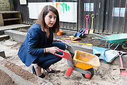 © Licensed to London News Pictures. 08/09/2015. London, UK. Labour party leadership candidate, LIZ KENDALL MP with a wheelbarrow in the sandpat during her visit to Clapham Manor Children's Centre in south west London. Photo credit : Vickie Flores/LNP