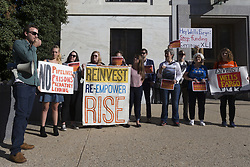 October 3, 2017 - Washington, District Of Columbia, USA - Protesters outside the Dirksen Senate Office Building prior to a hearing during which Timothy Sloan, President and Chief Executive Officer of Wells Fargo, testified before  United States Senate Banking Committee about Wells Fargo's 2016 banking scandal involving fraudulent accounts. (Credit Image: © Alex Edelman via ZUMA Wire)