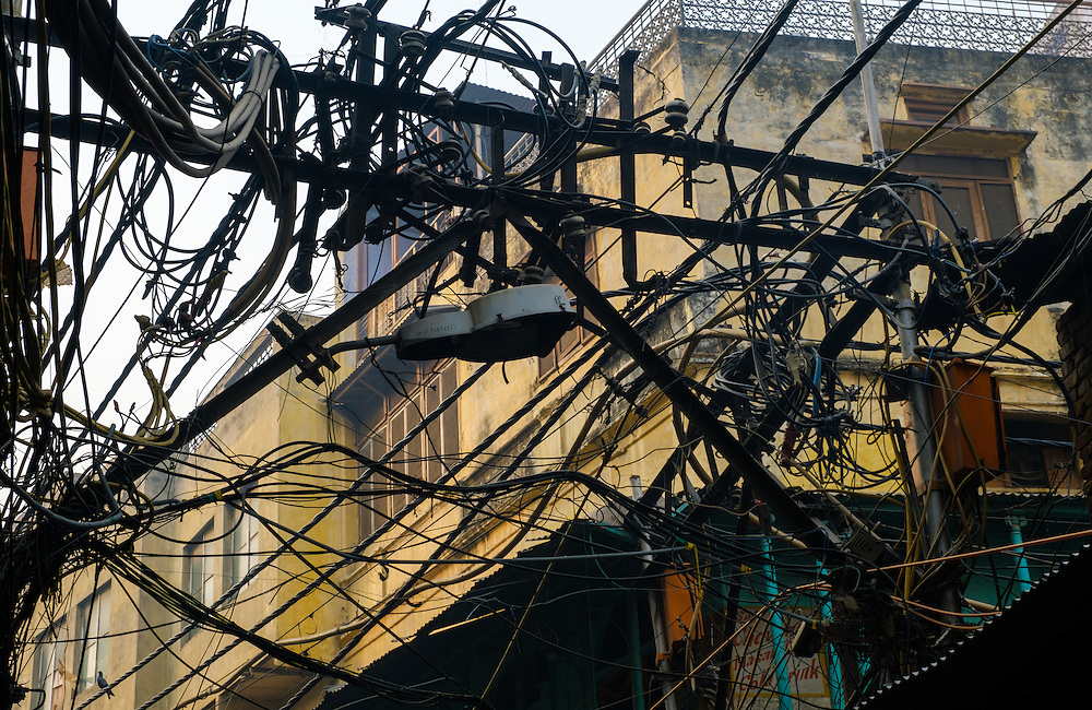 NEW DELHI, INDIA - CIRCA OCTOBER 2016: Maze of cables on the streets of Old Delhi.