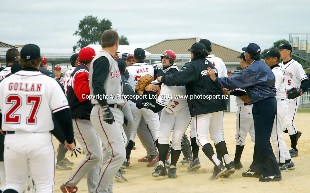 7th February 2004, ISF Men's Softball World Championships, Christchurch, New Zealand.<br />NZ Black Sox vs Team Canada.<br />A fight breaks out .<br />Pic: Sandra Teddy/Photosport