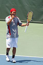 May 23, 2011; Stanford, CA, USA;  Shuhei Uzawa celebrates after defeating the Virginia Cavaliers in the #2 doubles match during the semifinals of the men's team 2011 NCAA Tennis Championships at the Taube Family Tennis Center.