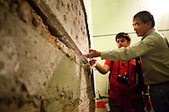 Dr. Benson Shing and his research assistant Andreas Stavridis inspect a large crack in a hospital stairwell in Mexicali. A group of researchers led by Dr. Shing, Vice Chair of the Department of Structural Engineering at the University of California, San Diego, inspected the earthquake damage in Mexicali, Mexico, April 7, 2010. A 7.2 magnitude earthquake in Baja California on Easter Sunday was felt as far away as Los Angeles.
