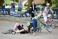 © Licensed to London News Pictures. 01/08/2015. LONDON, UK. Two riders crash while avoiding a woman lying injured (not seen) during the 10th Brompton World Championship bike race. The annual event sees over 500 competitors use the folding bicycles to race round St James' Park for up to 8 laps. Photo credit: Cliff Hide/LNP