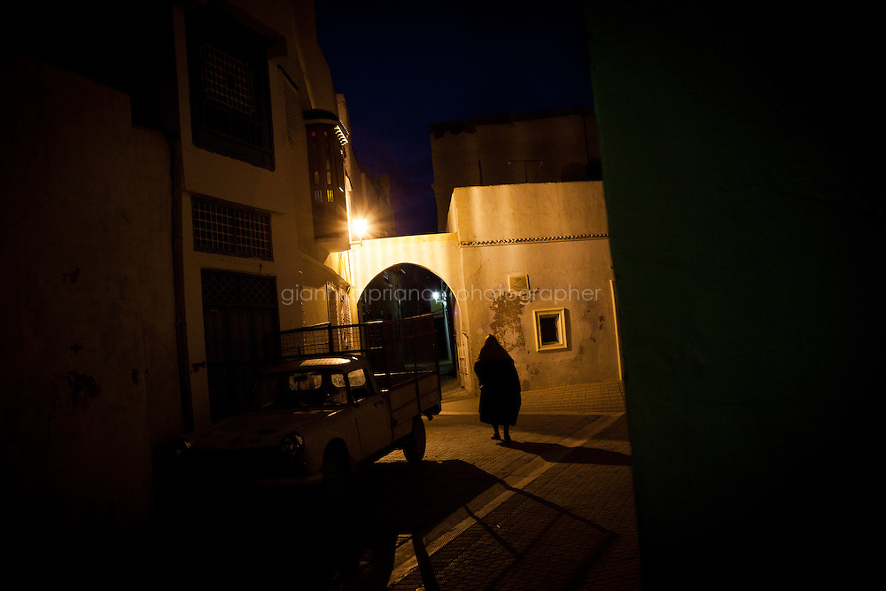 Kairouan, Tunisia - 18 December, 2011: A man walks after the dawn prayer at the  Great Mosque of Sidi-Uqba in Kairouan, Tunisia on 18 December, 2011. Said Ferjani, 57, senior member of the political and communication bureau of the Nahda (Renaissance) party, started his activism in the Negra mosque of his hometown Kairouan when he was 16 years old, debating on politics, philosophy, economy and world events. In 1989 former dictator Zine El Abidine Ben Ali turned against Nahda (or Ennahda) and jailed 25,000 activists. Said Ferjani was jailed and tortured. He then flew Tunisia and moved to the UK. He came back to Tunisia after 22 years, after former dictator Ben Ali flew the country.<br /> <br /> Gianni Cipriano for The New York Times