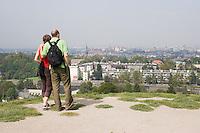 Couple admire the view from the Krakus Mound in Podgorze Krakow Poland