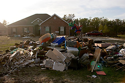 03 November, 2005. New Orleans, Louisiana. Post Katrina. <br /> A huge pile of household trash, flooded by the storm lies outside a Saint Bernard parish home washed out by Katrina. Hurricane Katrina caused a 20ft tidal surge to sweep over the land, devastating much of the parish.<br /> Photo; ©Charlie Varley/varleypix.com