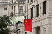 The red Chinese national flag hangs outside the Bank of China on Lothbury Street EC2 in the City of London - the capital's financial district, on 21st August 2018, in London, England. At a time when economic and property investment agreements between Britain and China were confirmed, the Chinese communist state's presence in the UK capital is becoming more obvious.