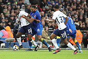 AFC Wimbledon midfielder Liam Trotter (14) battles for possession with Victor Wanyama of Tottenham Hotspur (12)  during the The FA Cup 3rd round match between Tottenham Hotspur and AFC Wimbledon at Wembley Stadium, London, England on 7 January 2018. Photo by Matthew Redman.