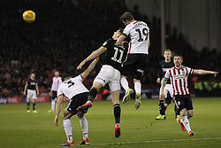 February 13, 2019 - Sheffield, South Yorkshire, United Kingdom - SHEFFIELD, UK 13TH FEBRUARY Richard Stearman of Sheffield United beats Middlesbrough's Jordan Hugill to head clear during the Sky Bet Championship match between Sheffield United and Middlesbrough at Bramall Lane, Sheffield on Wednesday 13th February 2019. (Credit: Mark Fletcher | MI News) (Credit Image: © Mi News/NurPhoto via ZUMA Press)
