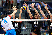 Poland, Krakow - 2017 September 03: (left) Nemanja Petric from Serbia spikes against Matthias Valkiers and Simon Van De Voorde and Sam Deroo all from Belgium while Third Place match between Belgium and Serbia during LOTTO EUROVOLLEY POLAND 2017 - European Championships in volleyball  at Tauron Arena on September 03, 2017 in Krakow, Poland.<br /> <br /> Mandatory credit:<br /> Photo by &copy; Adam Nurkiewicz<br /> <br /> Adam Nurkiewicz declares that he has no rights to the image of people at the photographs of his authorship.<br /> <br /> Picture also available in RAW (NEF) or TIFF format on special request.<br /> <br /> Any editorial, commercial or promotional use requires written permission from the author of image.