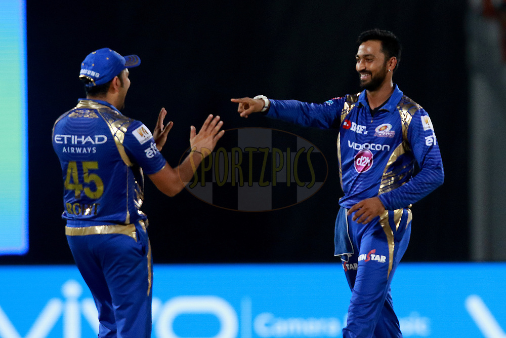 Krunal Pandya of MI celebrates after takes a catch of Ravindra Jadeja of GL during match 35 of the Vivo 2017 Indian Premier League between the Gujarat Lions and the Mumbai Indians  held at the Saurashtra Cricket Association Stadium in Rajkot, India on the 29th April 2017<br /> <br /> Photo by Rahul Gulati - Sportzpics - IPL