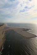 Nederland, Zuid-Holland, Gemeente Westland, 23-05-2011; Delflandse Kust ter hoogte van Ter Heijde en Monster, kassengebied van het Westland op het tweede plan..Zandmotor, aanleg van kunstmatig schiereiland door het opspuiten van zand voor de kust. Wind, golven en stroming zullen het zand langs de kust verspreiden waardoor breder stranden en duinen ontstaan. De zandmotor is een experiment in het kader van kustonderhoud en kustverdediging. In de achtergrond de kassen van het Westland..Sand Engine, construction of artificial peninsula by the raising of sand for the coast of Ter Heijde (near the Hague, at the horizon). Wind, waves and currents will distribute the sand along the coast yielding wider beaches and dunes along the coastline. The Sand Engine is a experiment for coastal maintenance of coastal defense. In the background the Westland greenhouses..luchtfoto (toeslag); aerial photo (additional fee required).foto Siebe Swart / photo Siebe Swart