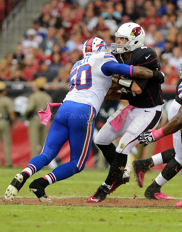 Oct. 14, 2012; Glendale, AZ, USA;  Arizona Cardinals quarterback Kevin Kolb (4) is sacked by Buffalo Bills linebacker Nick Barnett (50) at University of Phoenix Stadium. The Bills defeated the Cardinals 19-16 in overtime. Mandatory Credit: Jennifer Stewart-US PRESSWIRE..