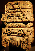 Pillar capital. Sandstone, Uttar Pradesh, AD900-1100.  This pillar capital from a temple incorporates diverse lotus or foliate imagery, and an auspicious kirttimukha ('face of god') appears on each side.