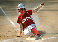 FAIRLESS HILLS, PA - MAY 27:  Bristol's Tianna Brewington slides into home plate scoring one of the 10 runs scored against Morrisville during a District One Class A softball semifinal game May 27, 2014 in Fairless Hills, Pennsylvania. Bristol defatted Morrisville 10-0 in five innings. (Photo by William Thomas Cain/Cain Images)