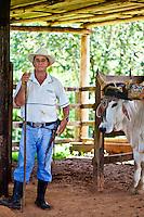 Portrait of a man and his ox, Finca Si Como No, Santa Juana, Costa Rica.