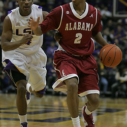 Jan 09, 2010; Baton Rouge, LA, USA; Alabama Crimson Tide guard Mikhail Torrance (2) drives past LSU Tigers guard Chris Bass (4) during the second half at the Pete Maravich Assembly Center. Alabama defeated LSU 66-49.  Mandatory Credit: Derick E. Hingle-US PRESSWIRE