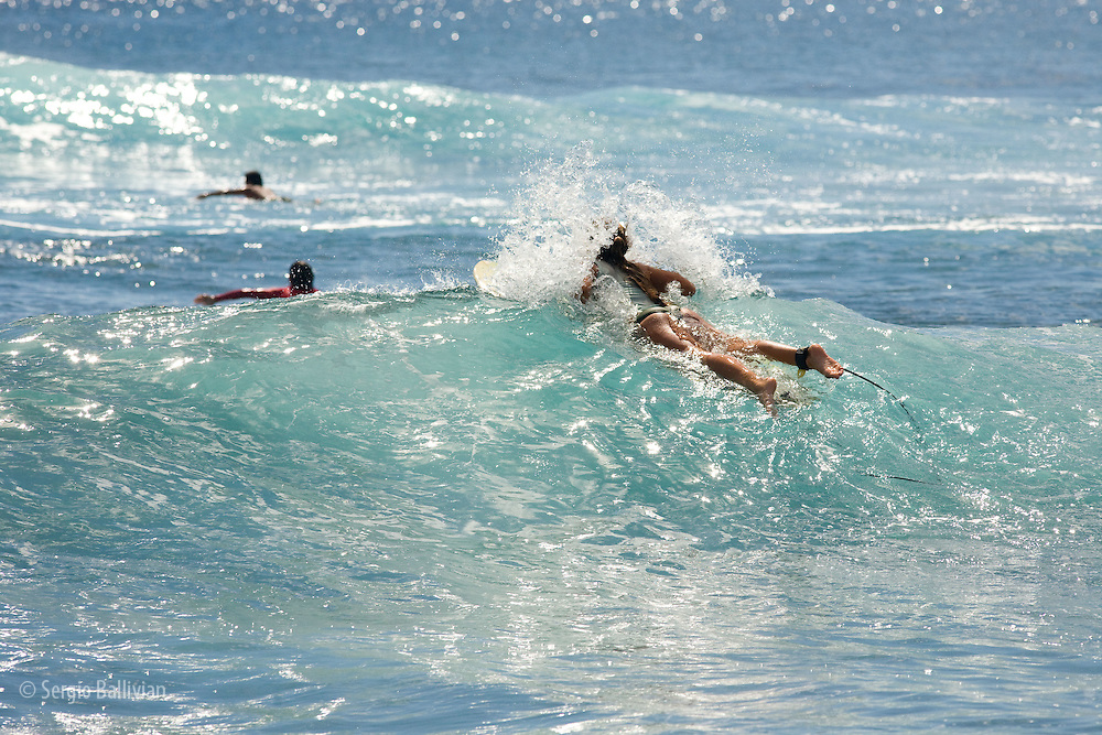 Female surfers on the Pacific Ocean off the island of Kauai, Hawaii