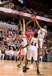 North Carolina State forward/center J.J. Hickson (1) shoots over Virginia forward/center Ryan Pettinella (34) and forward Jamil Tucker (12).  The Virginia Cavaliers men's basketball team defeated the North Carolina State Wolfpack 78-60 at the John Paul Jones Arena in Charlottesville, VA on February 24, 2008.