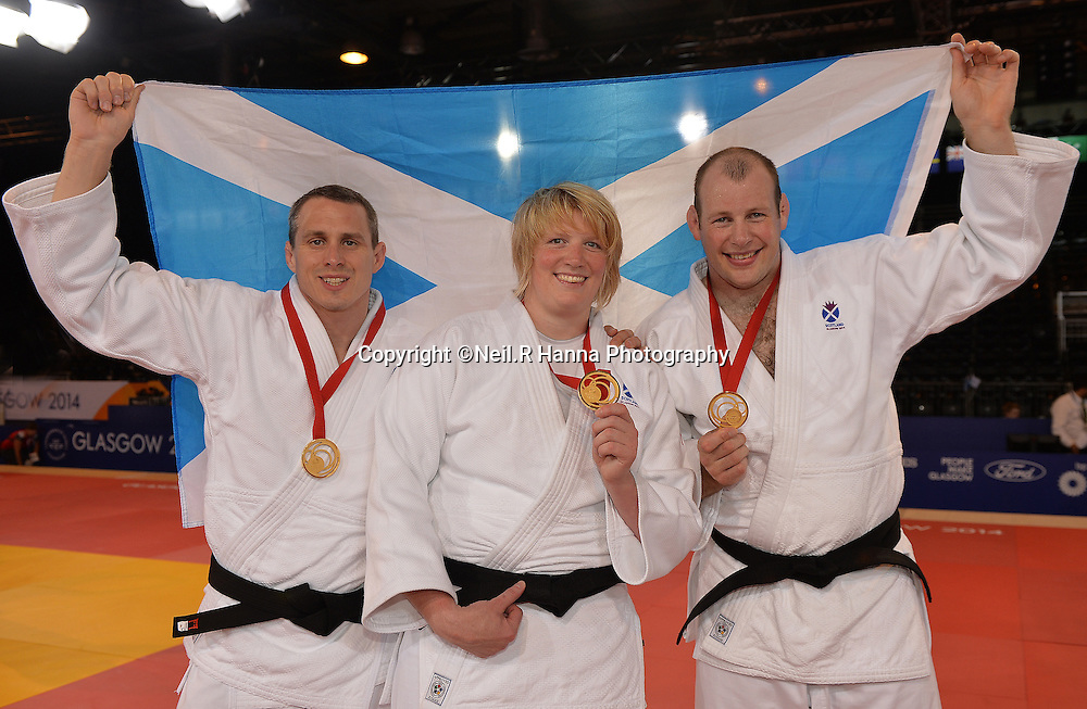 Commonwealth Games, Glasgow 2014<br />  26.07.2014<br /> SECC Judo<br /> Gold Medal<br /> Euan Burton, Sarah Adlington and Christopher Sherrington<br /> <br />  Neil Hanna Photography<br /> www.neilhannaphotography.co.uk<br /> 07702 246823