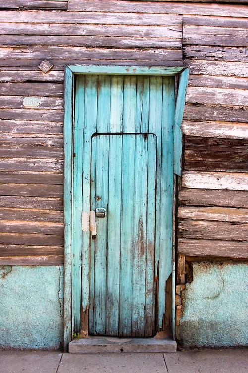 Old wooden door in an old wooden house, Cardenas, Matanzas, Cuba.