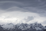 Snow-capped mountain range with threatening clouds overhead, South West Coast, South Georgia Island