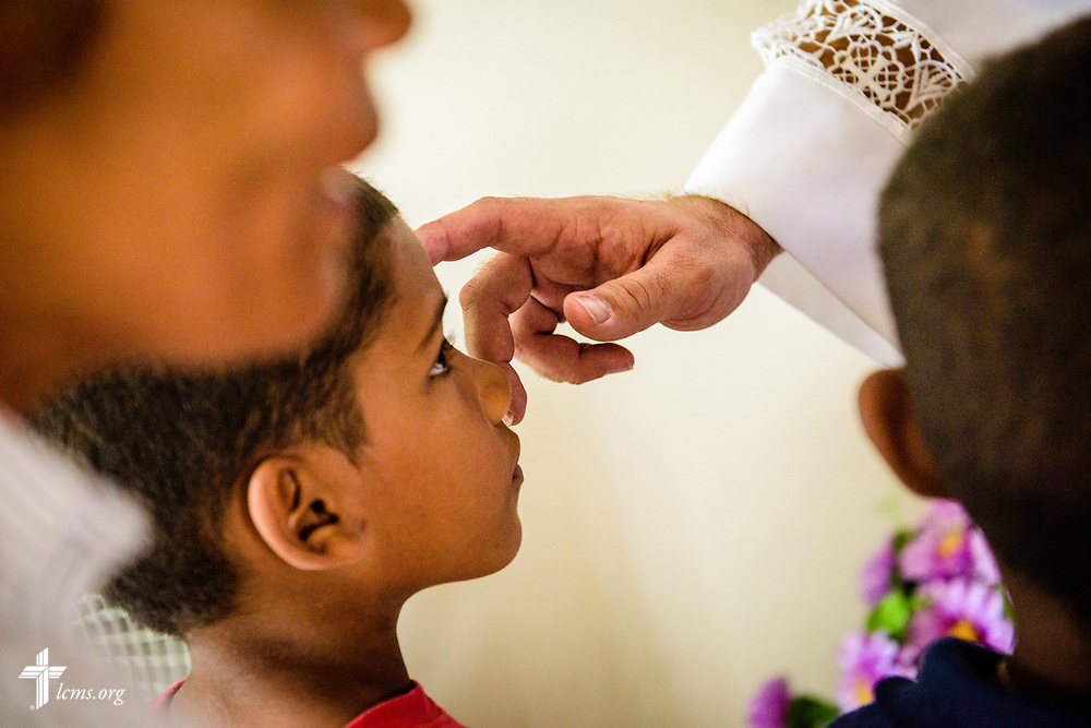 Children receive a blessing during communion led by the Rev. Joel Fritsche, LCMS career missionary to the Dominican Republic, on Sunday, March 19, 2017, at Amigos de Cristo Iglesia Luterana in Las Americas (Friends of Christ Lutheran Church in the Americas) in Santo Domingo, Dominican Republic. LCMS Communications/Erik M. Lunsford