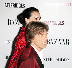 Mick Jagger; L'Wren Scott, Harper's Bazaar Women of the Year Awards, Claridge's Hotel, London UK, 05 November 2013, Photo by Richard Goldschmidt © Licensed to London News Pictures. Photo credit : Richard Goldschmidt/Piqtured/LNP