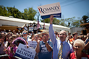 Supporters cheer for GOP presidential candidate Gov. Mitt Romney at a campaign rally at Carter Machinery Company in Salem, Virginia, June 26, 2012.