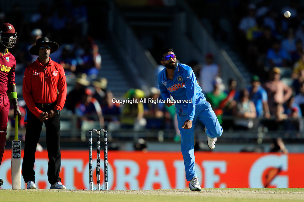 06.03.2015. Perth, Australia. ICC Cricket World Cup. India versus West Indies. Ravindra Jadeja bowls during the West Indian innings.