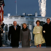 Presidential Inauguration 2005- GEORGE W. BUSH.Washington, DC.01/19/2005.Celebration of Freedom.The Ellipse- Washington, DC..US President George W Bush and Vice President Dick Cheney and their wives arrive at celebration. U.S. President George W. Bush (R), first lady Laura Bush (2nd R), Vice President Dick Cheney (L) and Lynne Cheney (2nd L) arrive on stage for 'A Celebration of Freedom' on The Ellipse in Washington..Photo by Khue Bui.